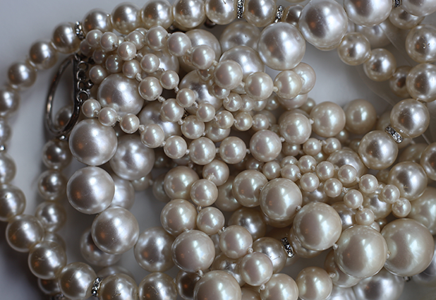 Pearl header for rich jewelry out from under